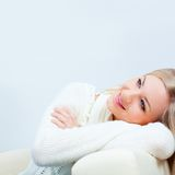 Happy woman wearing  white sweater Stock Photography