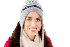 Happy woman wearing winter clothes smiling against Royalty Free Stock Images