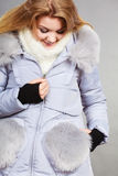 Happy woman wearing winter warm furry jacket Royalty Free Stock Images