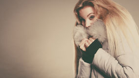 Happy woman wearing winter warm furry jacket Royalty Free Stock Image