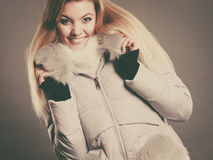 Happy woman wearing winter warm furry jacket Stock Images
