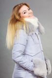 Happy woman wearing winter warm furry jacket Royalty Free Stock Photos