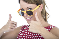 Happy Woman Wearing Yellow Sun Glasses Giving Thumbs Up Royalty Free Stock Photos