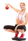 Happy woman weighing scale. Healthy nutrition . Stock Image