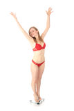 Happy woman on weight scale Stock Photography