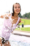Happy woman wet in the rain Stock Images