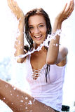Happy woman wet in the rain Royalty Free Stock Photos