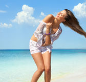 Happy woman in wet shirt on the beach Stock Photo