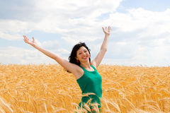 Happy woman in wheat Royalty Free Stock Image