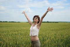 Happy woman at wheat field. Royalty Free Stock Photography