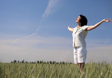 Happy woman on the wheat field Royalty Free Stock Image