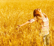 Happy woman on wheat field Stock Photo