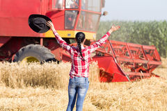 Happy woman in wheat field during harvest Stock Photo