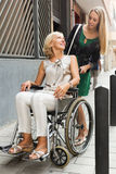 Happy woman in wheelchair Stock Images