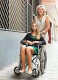 Happy woman in wheelchair outdoor Stock Photos