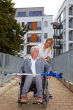 Happy woman in wheelchair on a ramp Royalty Free Stock Photography
