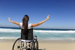 Happy woman in wheelchair showing victory sign Stock Photography