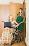 Happy woman in wheelchair  working on laptop Royalty Free Stock Photography