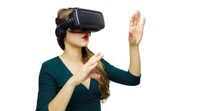 Happy woman on a white background in the studio gets the experience of using VR-glasses virtual reality headset.  stock images