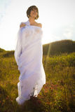 Happy woman in white fabrics in green outdoor Royalty Free Stock Photo