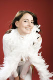 Happy Woman in White with Feathery Scarf Royalty Free Stock Image