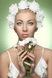 Happy woman with white flowers Royalty Free Stock Images