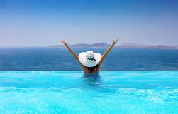 Woman with white hat in the pool Royalty Free Stock Photography