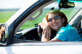 Happy woman in white new car at nature Stock Image