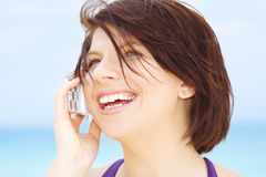 Happy woman with white phone Royalty Free Stock Photo