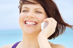 Happy woman with white phone Stock Photos