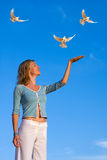 Happy woman and white pigeons Royalty Free Stock Photo