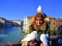 Happy woman with white pigeons ,Venice Royalty Free Stock Photo