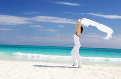 Happy woman with white sarong Royalty Free Stock Photography