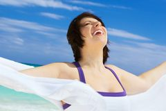 Happy woman with white sarong Stock Images