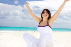 Happy woman with white sarong Royalty Free Stock Photos