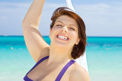 Happy woman with white sarong Stock Image