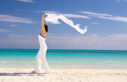 Happy woman with white sarong Stock Photos