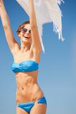 Happy woman with white sarong on the beach Stock Photos