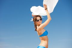 Happy woman with white sarong on the beach Royalty Free Stock Images