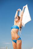 Happy woman with white sarong on the beach Stock Photo