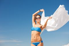 Happy woman with white sarong on the beach Royalty Free Stock Image