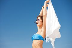 Happy woman with white sarong on the beach Stock Image