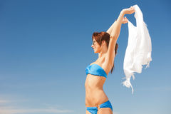 Happy woman with white sarong on the beach Royalty Free Stock Photo