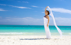 Happy woman with white sarong Royalty Free Stock Image