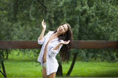 Happy woman in white shirt Stock Photo