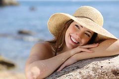 Happy woman with white smile looking sideways on vacations Royalty Free Stock Images