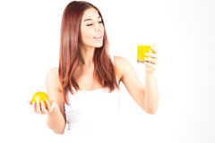 Happy woman with white teeth holding orange and glass of orange juice. Healty food. Royalty Free Stock Photo