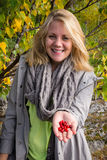Happy woman who offers lingonberry Stock Photos