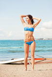 Happy woman with wind surf on the beach Royalty Free Stock Image