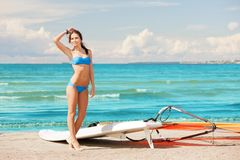 Happy woman with wind surf on the beach Stock Photography